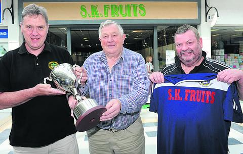 This Is Wiltshire: Chippenham Sunday League chairman Andy Hillier (left) and league development officer Mike Rogers (right) toast the new sponsorship partnership with Stuart Brown, of SK Fruits