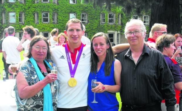 This Is Wiltshire: Ed McKeever with fiancée Anya Kuczha and parents Derek and Janice at a reception after his win