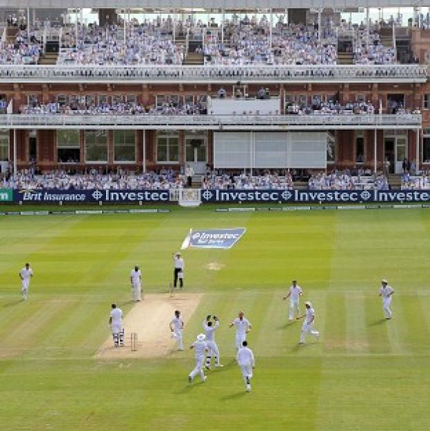 This Is Wiltshire: Stuart Broad celebrates taking the wicket of Alviro Petersen at Lord's