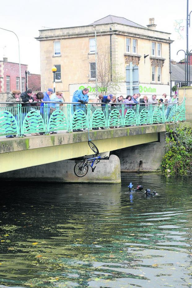 This Is Wiltshire: A bicycle is pulled out of the Avon during last year's clean-up