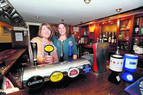 This Is Wiltshire: New Inn landlady Patsy Lowe, who is leaving the pub, pictured with her daughter Becky
