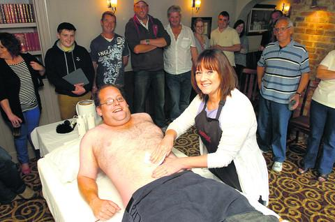 This Is Wiltshire: Dave Cook prepares for more pain as Jackie Lyons from Bliss Hair and Beauty continues waxing his chest in aid of the air ambulance