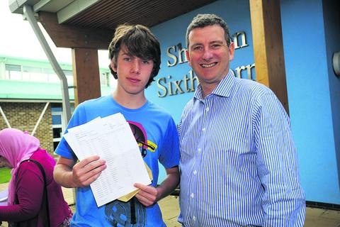 This Is Wiltshire: Headteacher Gerard MacMahon with pupil Matt Almond holding his GCSE resul