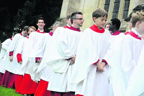 This Is Wiltshire: The choir heads in to Solemn Evensong at the Edington Music Festival event