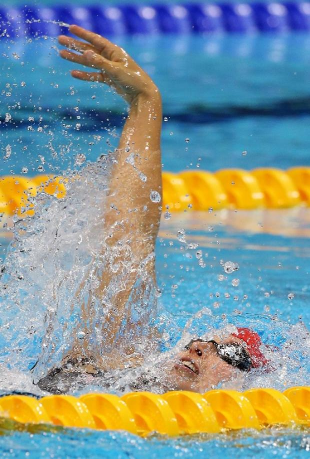 This Is Wiltshire: Stephanie Millward on her way to silver in the S9 100m backstroke at London's Aquatics Centre tonight
