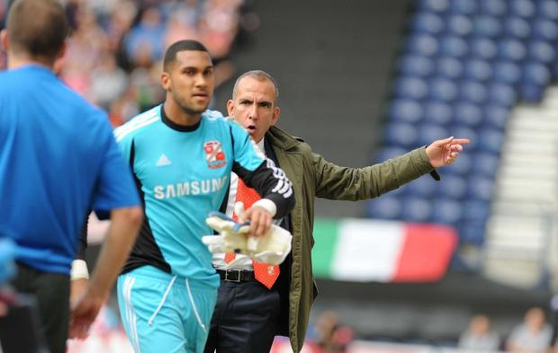 This Is Wiltshire: Wes Foderingham and Town boss Paolo Di Canio at Deepdale yesterday