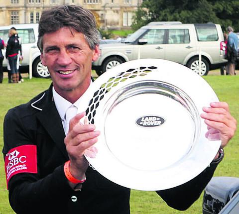 This Is Wiltshire: Andrew Nicholson celebrates his Burghley triumph