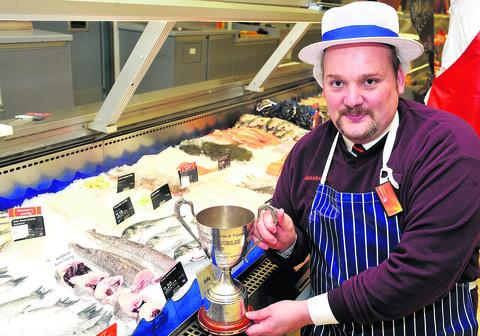 This Is Wiltshire: Simon Belcher at Sainsbury's with the Golden Jubilee Cup