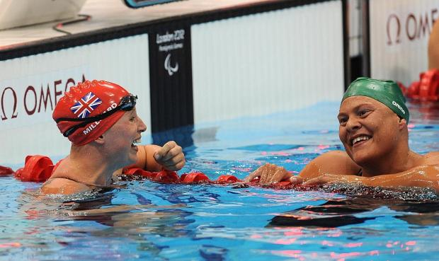 This Is Wiltshire: Stephanie Millward (left) with gold medal winner Natalie Du Toit after the 400m freestyle final tonight