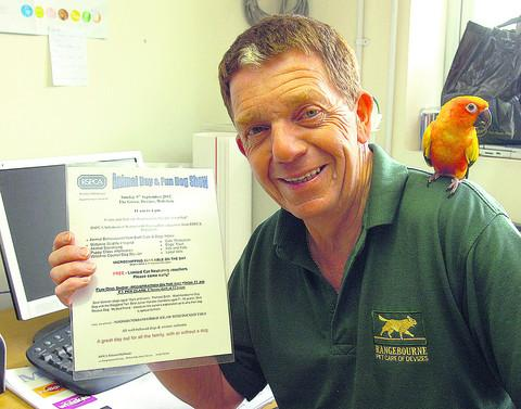 This Is Wiltshire: Andy Sheppard promotes the RSPCA event with the help of a feathered friend