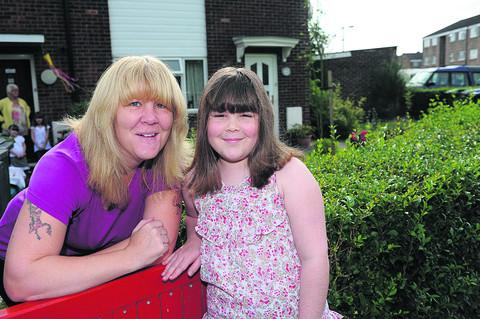 This Is Wiltshire: Maxine Armitage at home with her daughter, Daisy, after performing her fundraising skydive