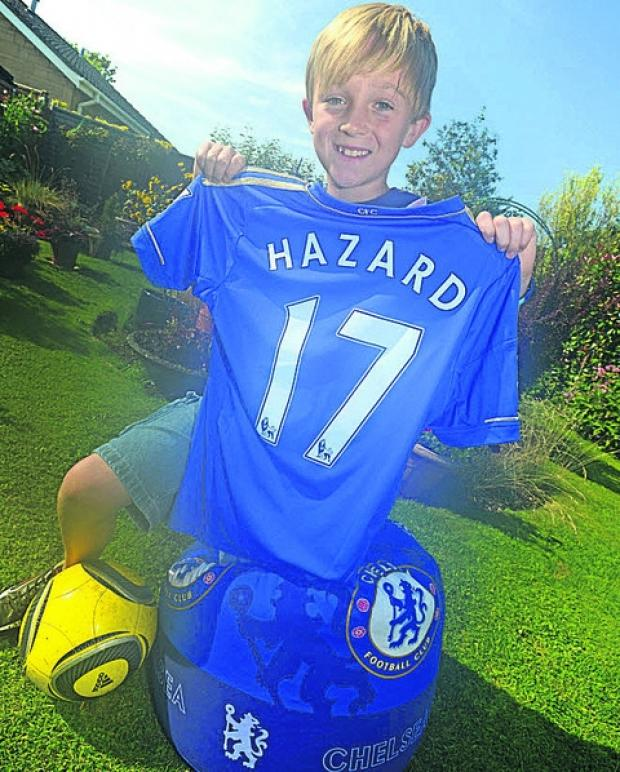 This Is Wiltshire: Chippenham youngster Jack Eden with the Chelsea shirt he'll wear as a matchday mascot at Stamford Bridge