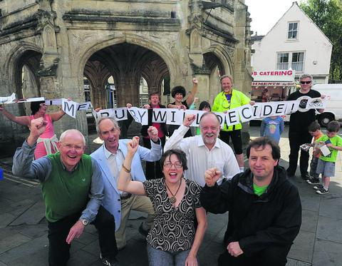 This Is Wiltshire: Residents and members of the steering group celebrate the postponement of two supermarket plans with, front from left, Roger Budgen, Bob Tallon, Kim Power, John Gundry and Simon Killane