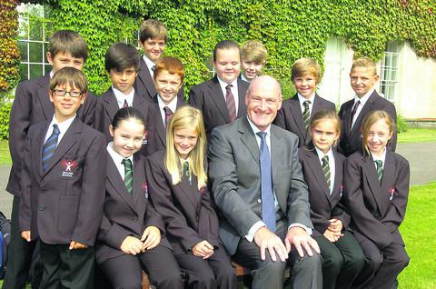 This Is Wiltshire: Devizes School's headteacher Malcolm Irons with Year 7 students in their new uniforms