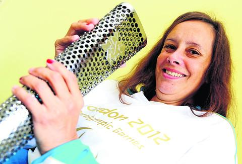 This Is Wiltshire: Vicki Cornish, who carried the Paralympic Torch through central London