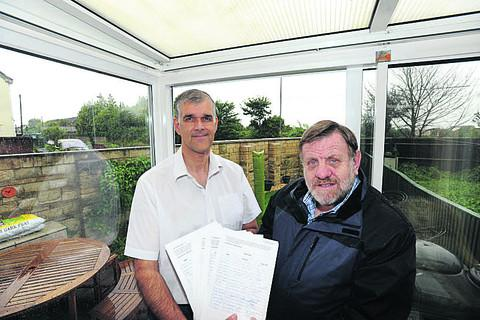 This Is Wiltshire: House owner Martin Weston hands the petition to Cllr Graham Payne