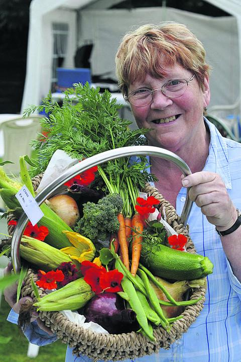 Gillian Plues and her six vegetables in a container entry
