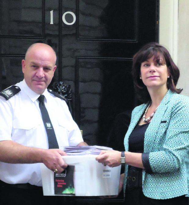 This Is Wiltshire: Claire Perry hands the online safety petition in at No. 10 Downing Street