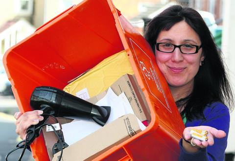 This Is Wiltshire: Sophie Corrigan with the orange recycling box