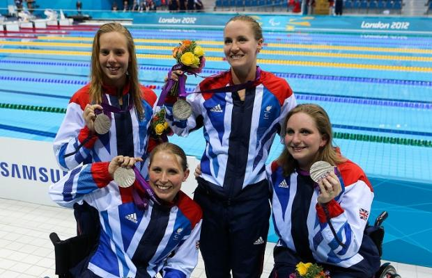 Stephanie Millward (front left) with the relay teammates and their silver medal