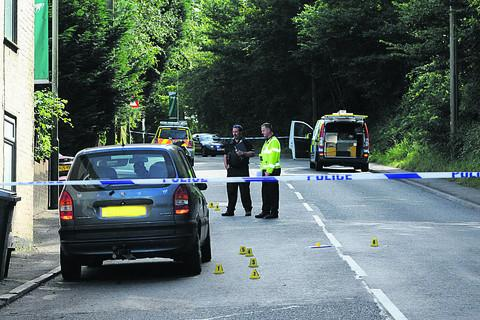 Crash investigators at the scene on Saturday