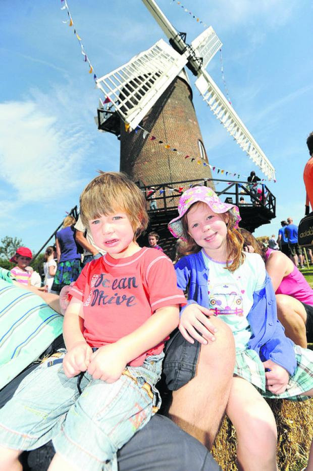 This Is Wiltshire: Ben and Ellie enjoy the sights and sounds of the Wilton Windmill open day