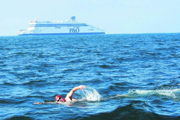 This Is Wiltshire: HARD WORK Matt Harris swimming the Channel in memory of Zak Hobbs with P&O Ferry in background