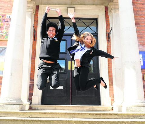This Is Wiltshire: Students Carli Green and Georgia Martin celebrate the third time in a row that The Commonweal School has won the Artsmark gold award