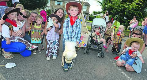 This Is Wiltshire: Mums and children dressed as cowboys and Indians at a fancy dress party launching Pewsey Carnival on Saturday