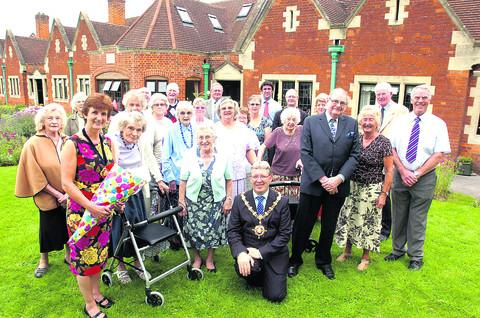 This Is Wiltshire: Devizes mayor Kelvin Nash with residents at the almshouses completion ceremony