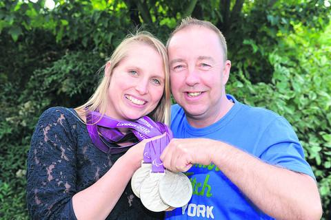 This Is Wiltshire: Stephanie Millward and husband-to-be Adrian McHugh with her medals