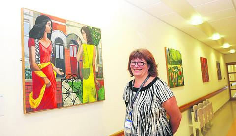 This Is Wiltshire: Chief pharmacist and the chairman of GWH arts committee Jane Coleborn with the exhibition by Tim Carroll