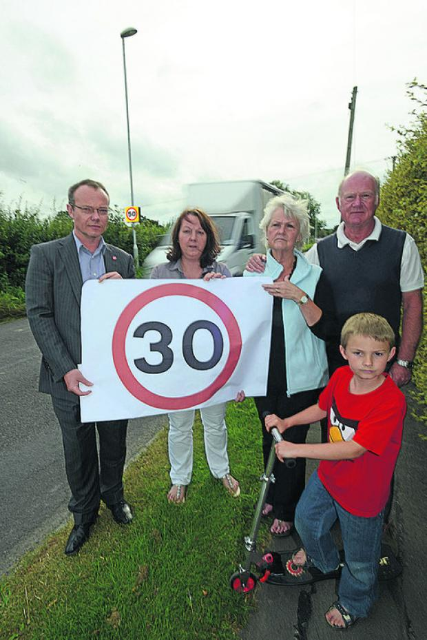 This Is Wiltshire: Mark Steve, Sarah Brogden, Chris Waring and Nigel Waring, and Oliver Brogden protest at the 50mph speed limit in Horton Road