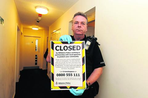 This Is Wiltshire: Sergeant Phil Connor closes a flat in a Monkton Park block