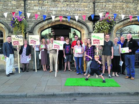 This Is Wiltshire: Residents who took part in a protest outside Malmesbury Town Hall against plans by Waitrose to open a supermarket behind Silk Mills