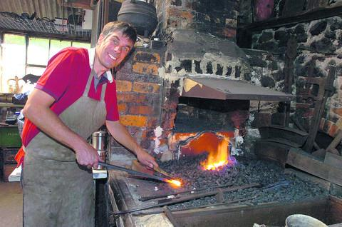 Former accountant turned blacksmith Marc Hart at the family forge which was last used in 1982