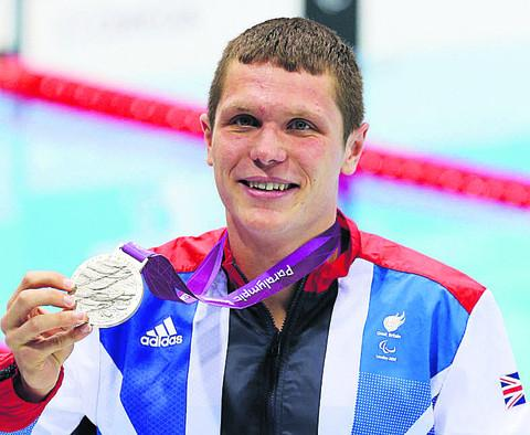 This Is Wiltshire: Aaron Moores and his silver medal are back home in Trowbridge