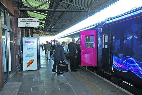 This Is Wiltshire: Commuters board the early London train at Westbury this week