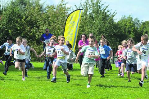 This Is Wiltshire: A total of 150 children take part in the fun run at Noremarsh School