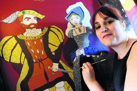 This Is Wiltshire: Charlotte Long works on one of her murals at the Green Dragon