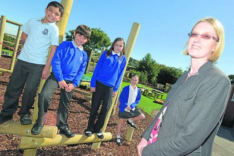 This Is Wiltshire: Departing headteacher Tracey Dunn with pupils Austin, Connor, Hannah and Hollie