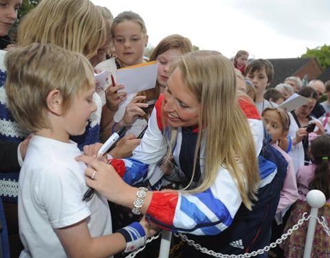 This Is Wiltshire: Stephanie Millward signs the T-shirt of one of her fans