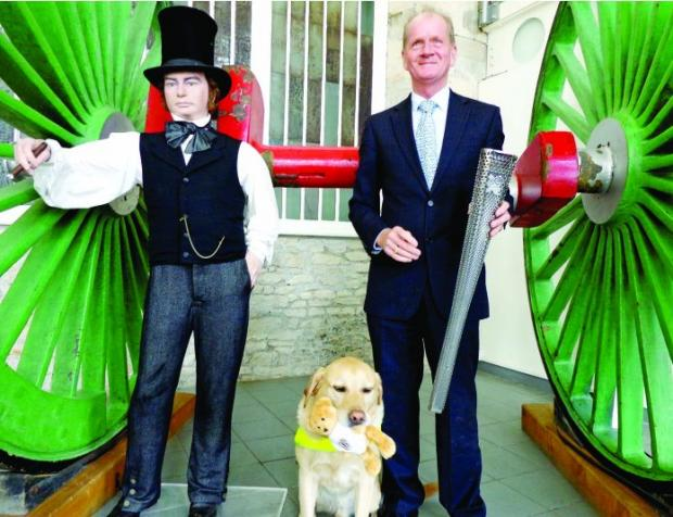 LEADING LIGHTS Guide Dog Brunel, with Tom McInulty and their Paralympic torch, meets engineer Brunel