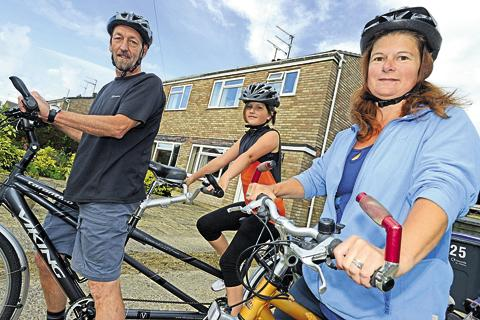This Is Wiltshire: Stuart, Lorna and daughter Eve Hislop cycle everywhere and have never owned a car