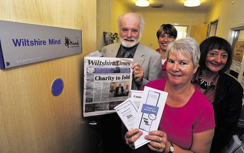 Chairman Geoff Brown, volunteer Judith Mott, general manager Carolyn Long, front, and client support officer Peggi Lewis