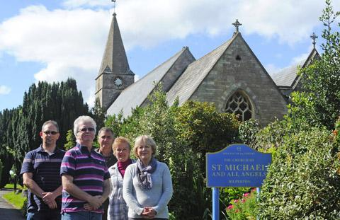 This Is Wiltshire: Hilperton parish councillor Viv Bielecki, left, chairman Ernie Clark, Mark and Viv Packer of Hilperton Allotment committee and clerk Marylyn Timms. Right, churchyard stalwart Ken Hall