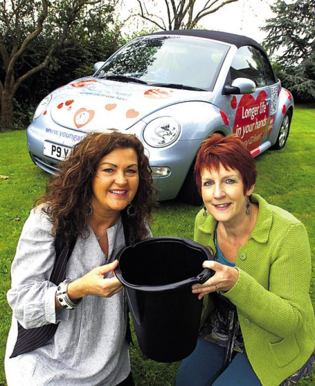 This Is Wiltshire: HEALS co-directors Amanda Richards and Elaine Godley with the charity's sponsored VW Beetle     (39882) Paul Morris