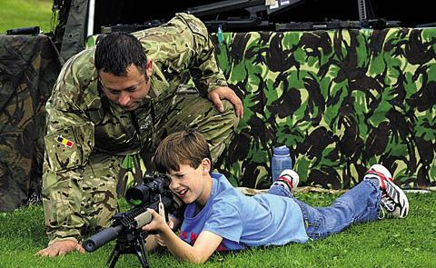 This Is Wiltshire: Thomas, 11, gets instructions from WO2 John Wilson