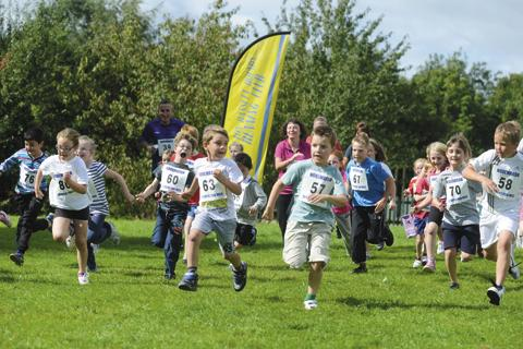 This Is Wiltshire: Youngsters are put through their paces at Noremarsh School's fun run
