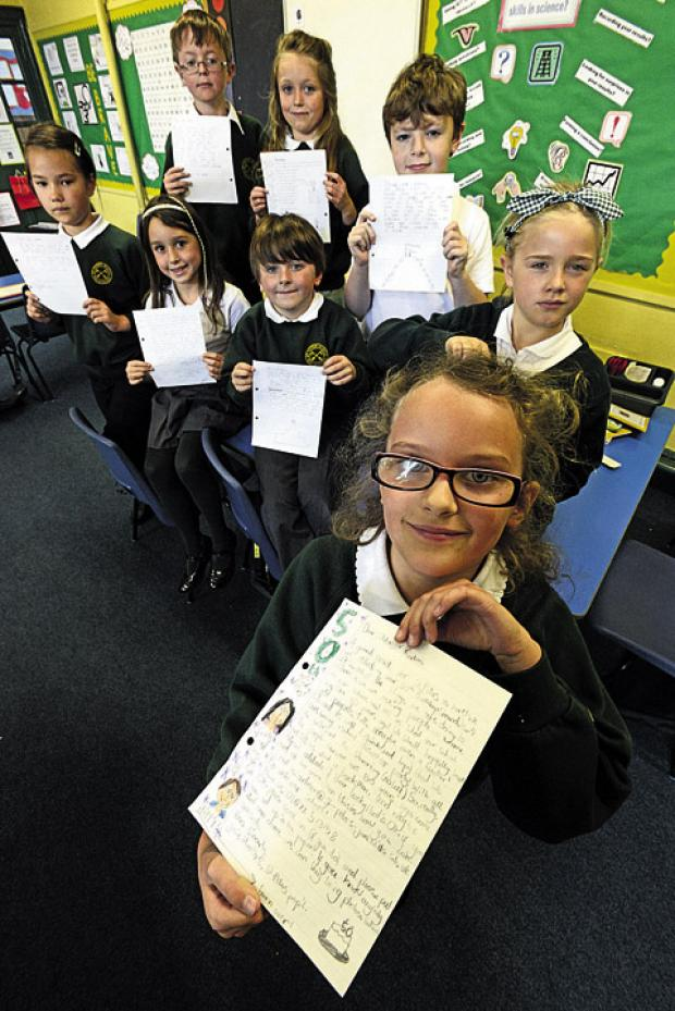 This Is Wiltshire: Children at St Peter's School with the letters they have written asking people to come forward with information